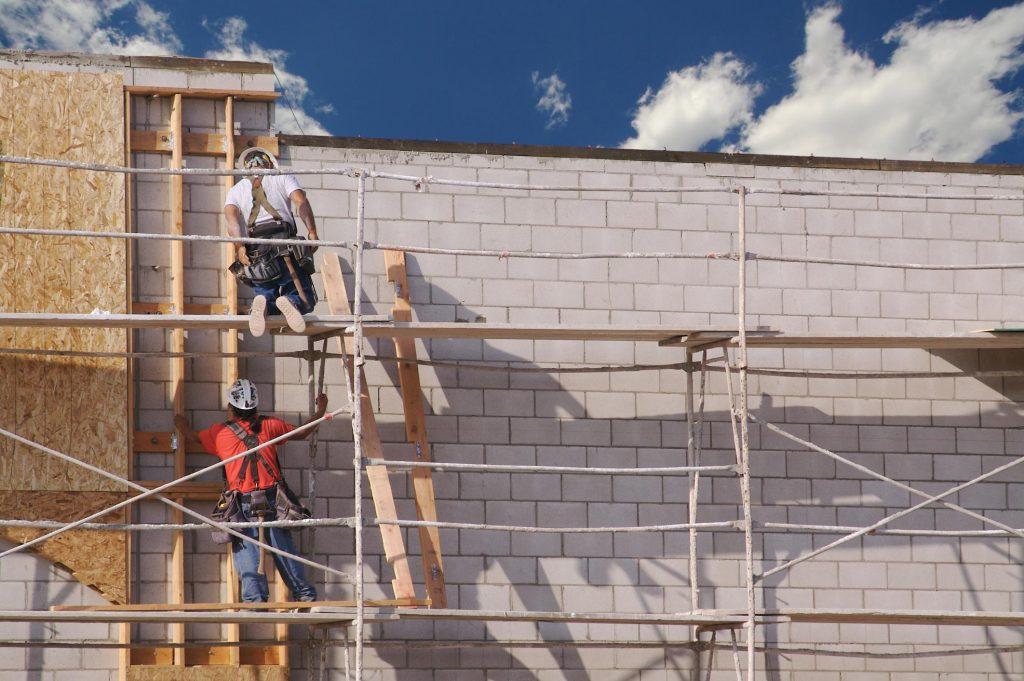 men installing the slabs