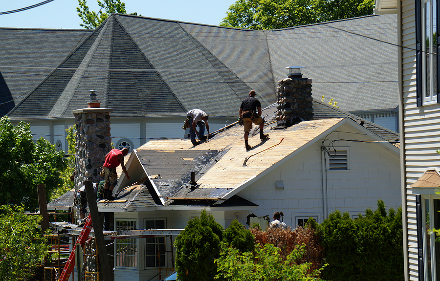 men constructing the roof